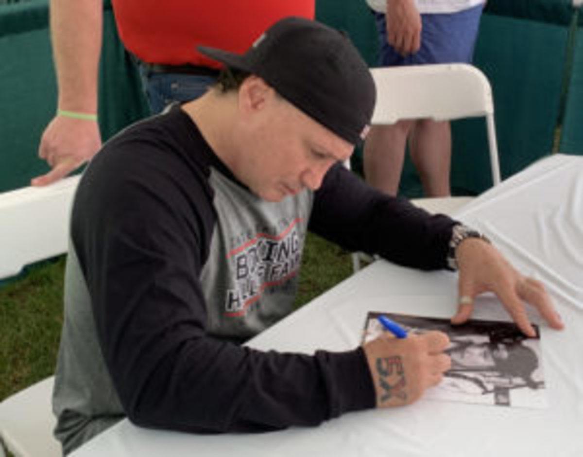 Vinny Paz signs autographs at the Golf Tournament.