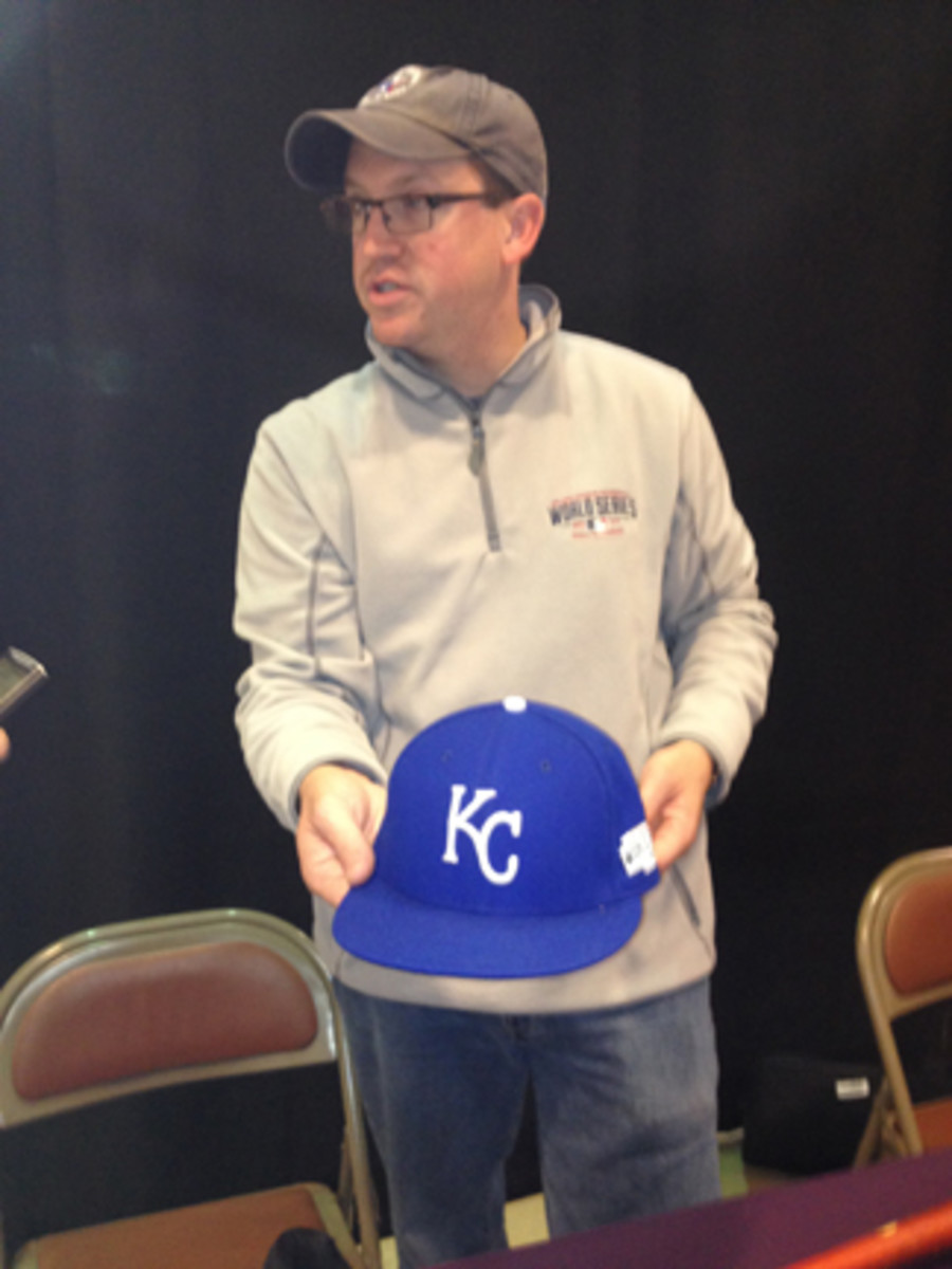 Brad Horn of the Baseball Hall of Fame shows off the cap of Brandon Finnegan.
