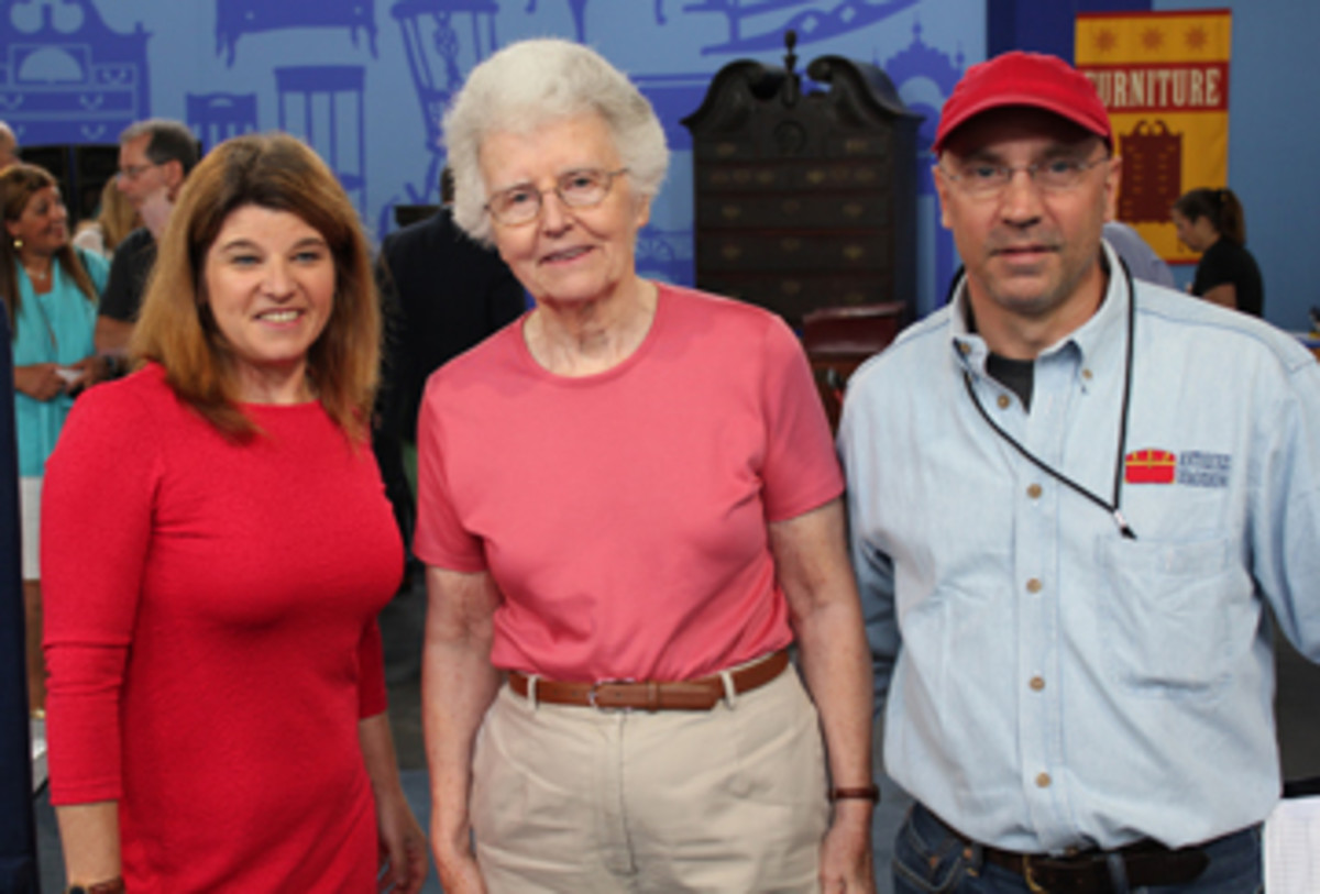 Appraiser Leila Dunbar (left) and supervising producer Sam Farrell, right, pose with the woman who brought in the heirloom collection of 1870s baseball memorabilia. Antiques Roadshow withholds the names of its guests for their privacy and safety.