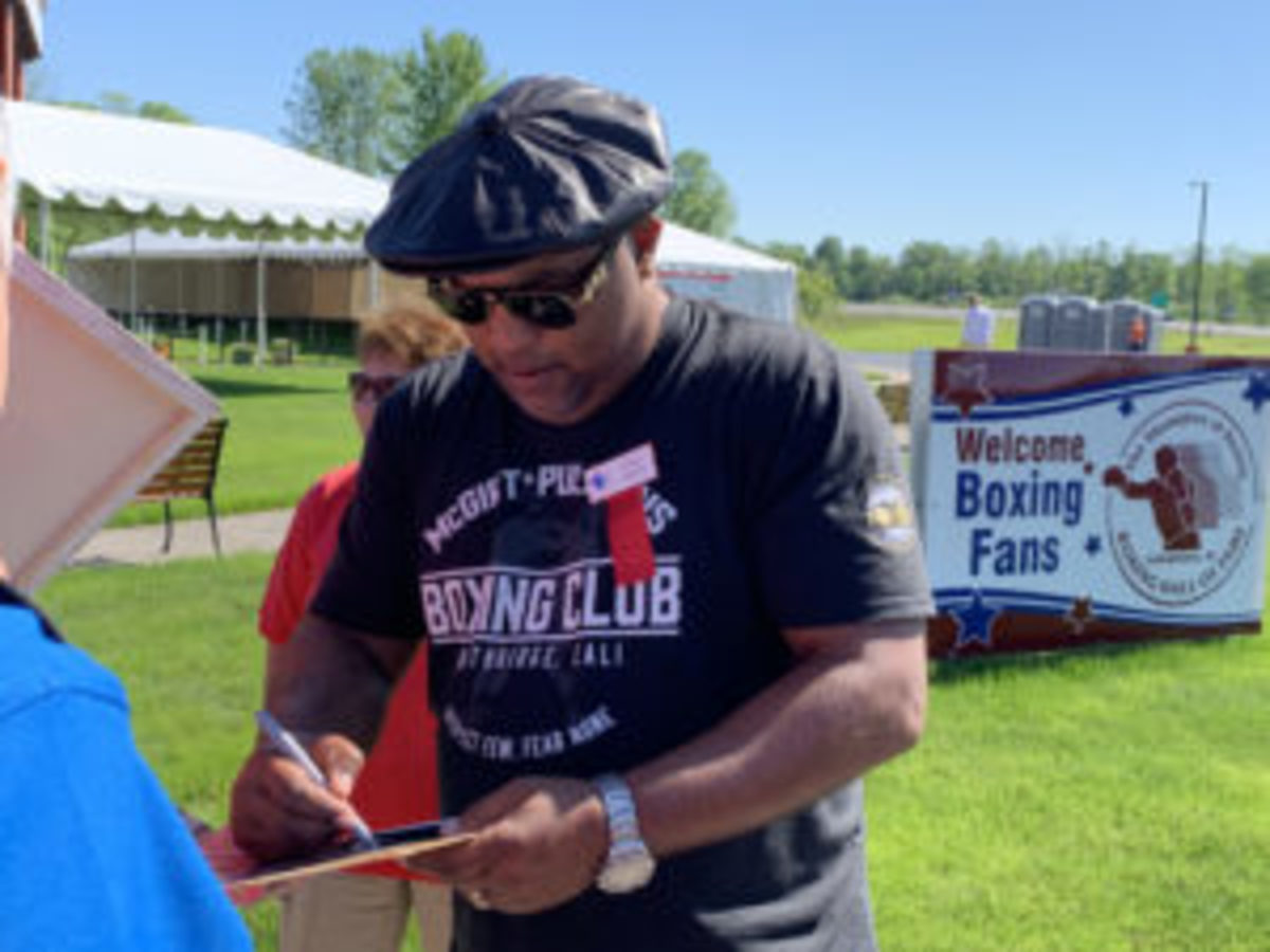 """James """"Buddy"""" McGirt, a member of the Class of 2019 being inducted in the International Boxing Hall of Fame takes time to sign an autograph on the Hall of Fame grounds."""