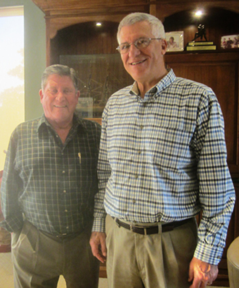 John Hamilton, left, with George Vrechek during a Dec. 2013, visit.