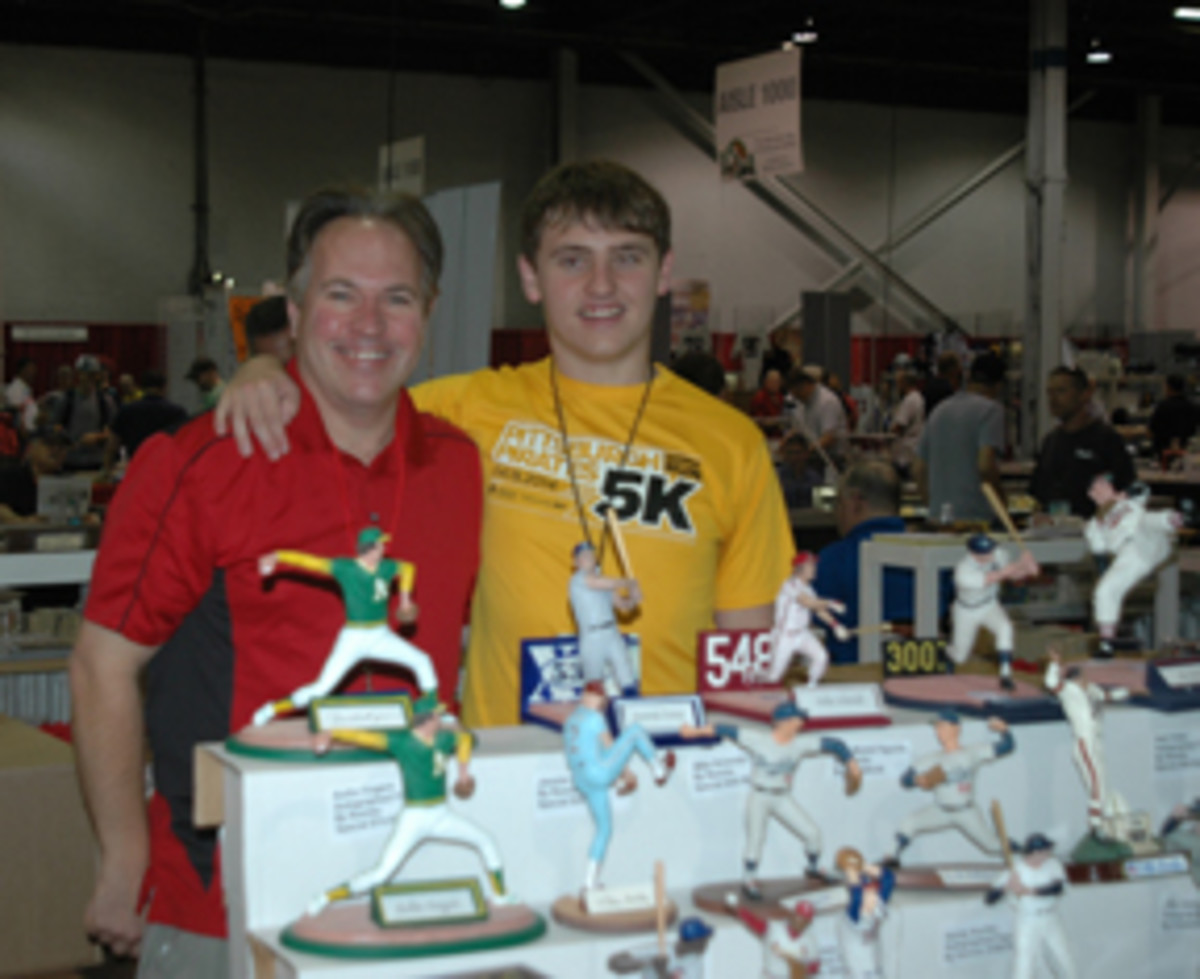 Rick Romito, shown with his son Peter at the 2015 National Sports Collectors Convention, is celebrating 25 years in the figurines business.