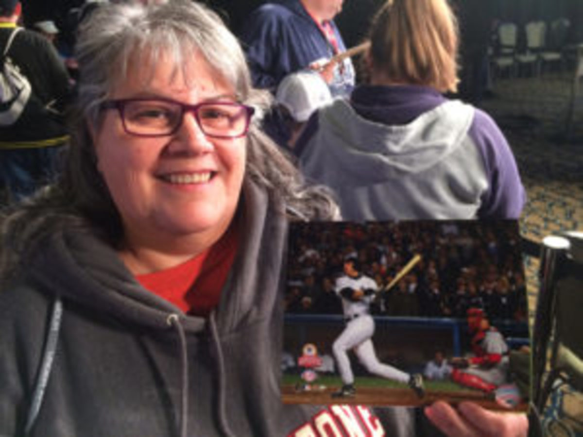 New York Yankees fan Denise Morehouse holds a photo of Aaron Boone's 2003 pennant winning home run. (Paul Post photo)