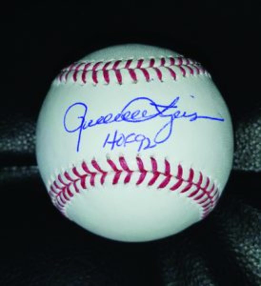 A baseball signed by Rollie Fingers.