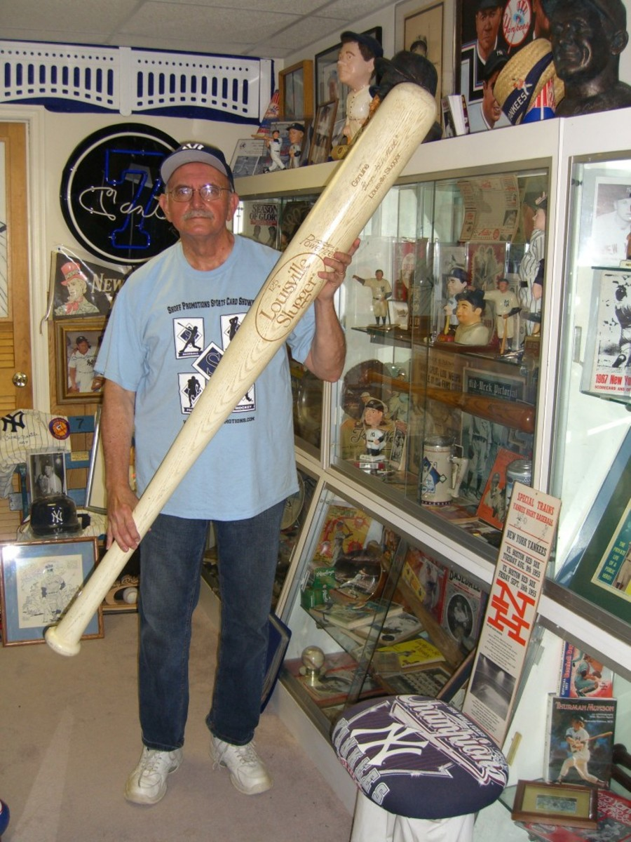 Nick Shoff poses among a section of his Yankee collection.
