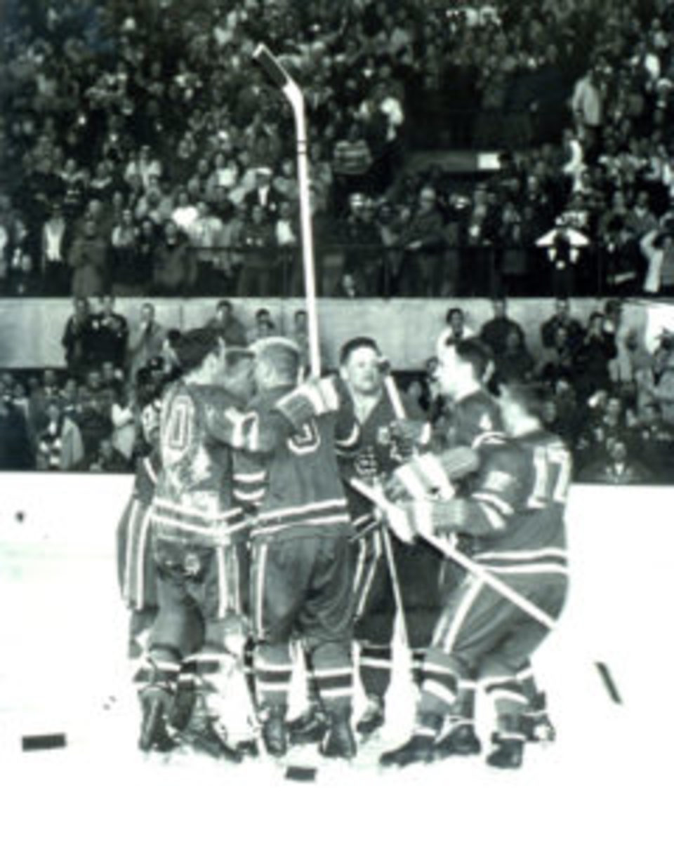 Team USA celebrates at the 1960 Olympic Winter Games.