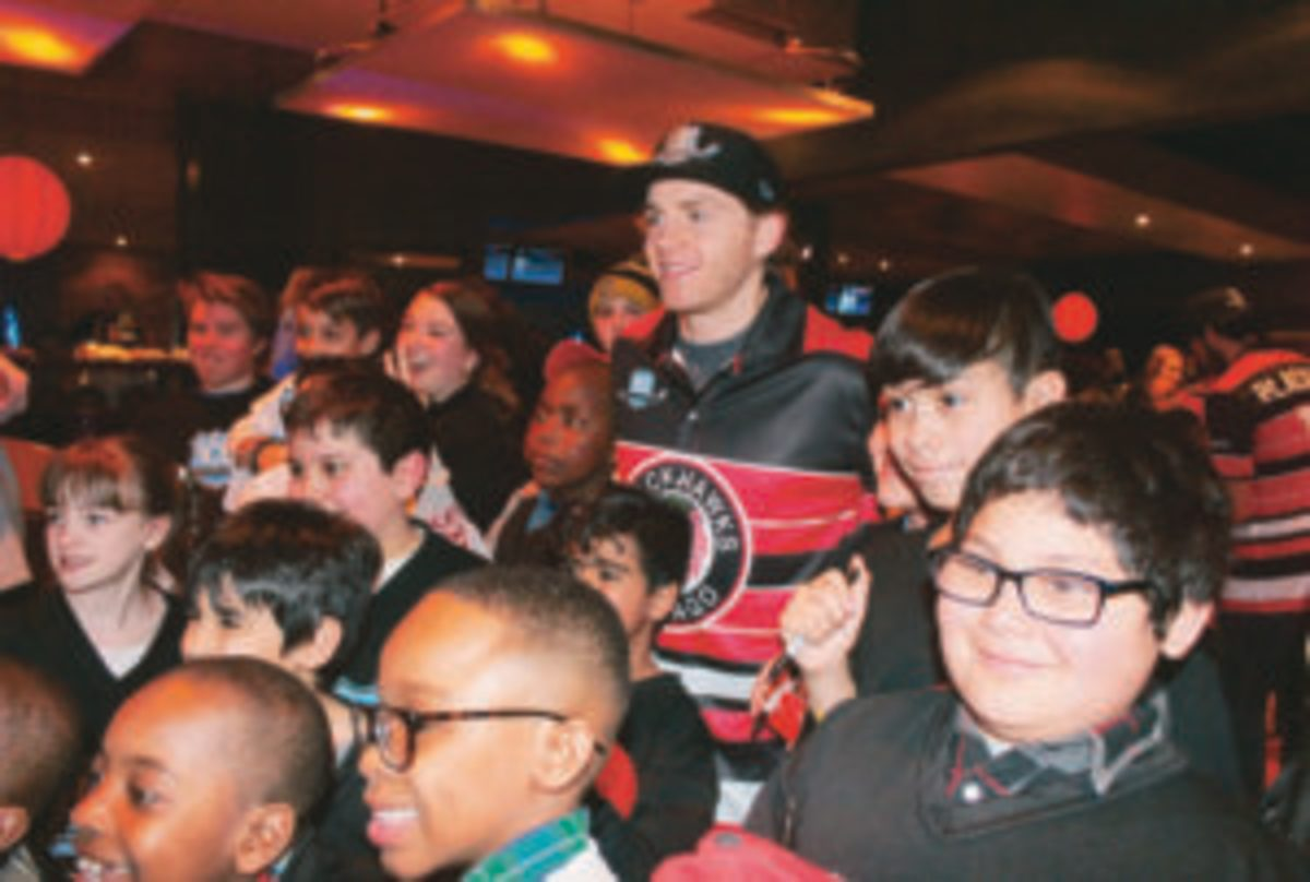 Patrick Kane poses with some of the kids who attended the 2018 Brent Seabrook Celebrity ICE Bowl to raise money for the Inner-City Education program.