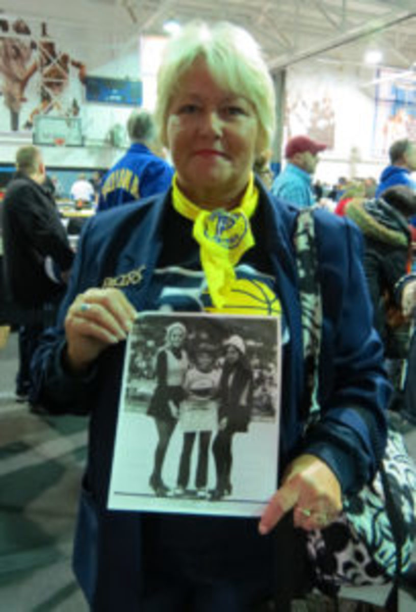 Roseanna (Thompson) Head shows off a photo from her days as one of the original Indiana Pacers cheerleaders. She became a Pacemate the year after the team won their first ABA championship.