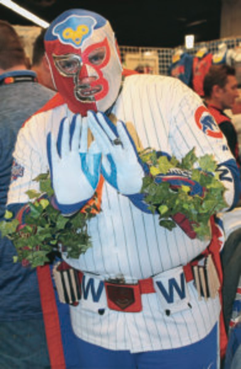 Some of the fans at the Cubs Convention, like this one, dressed in the best Cubs wardrobe. Notice the Wrigley Field ivy on his arms.