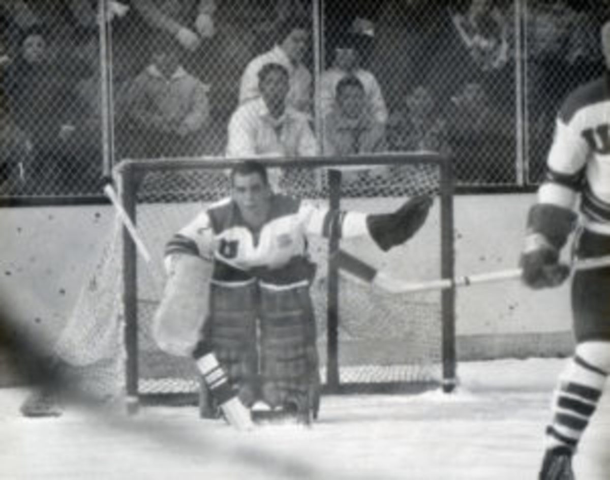 Jack McCartan (No. 2) of Team USA defends the net during the Ice Hockey tournament at the 1960 Winter Olympic Games at Blyth Arena in Squaw Valley, California. (Photo by Robert Riger/Getty Images)