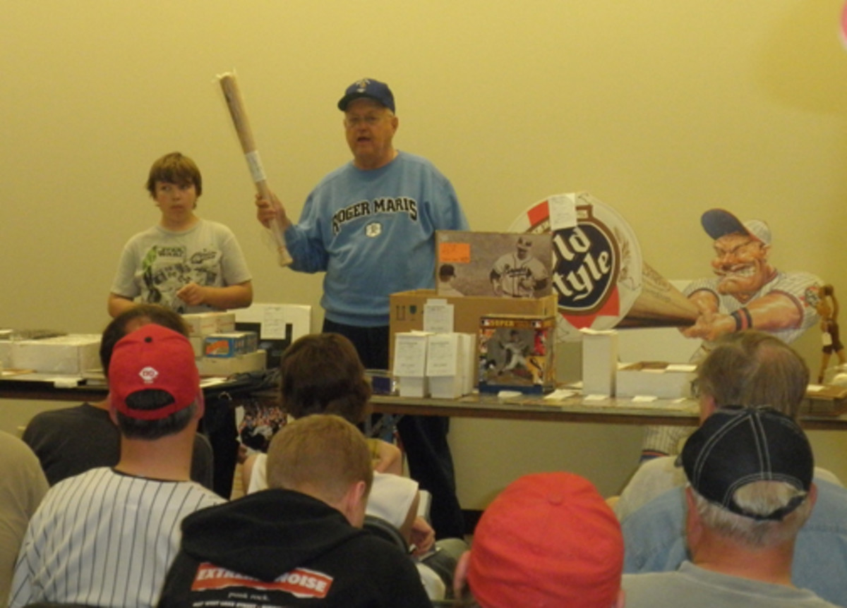 """Dick """"The Polish Eagle"""" Jonckowski, auctions a Twins mini bat at a recent Twin Cities Sports Collectors Club auction."""
