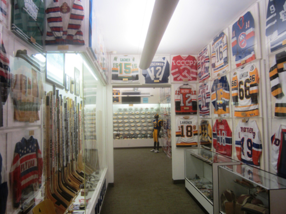 The museum's hockey room leads into the football room. Much of the L.A. Kings items in the collection will be part of SCP Auctions' sale in May.