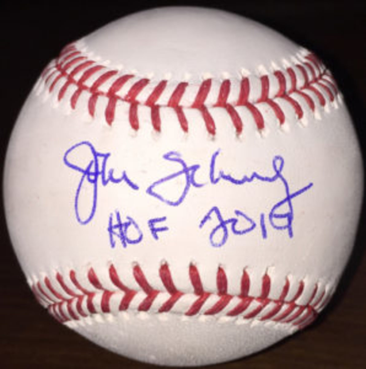 A baseball autographed by John Schuerholz.