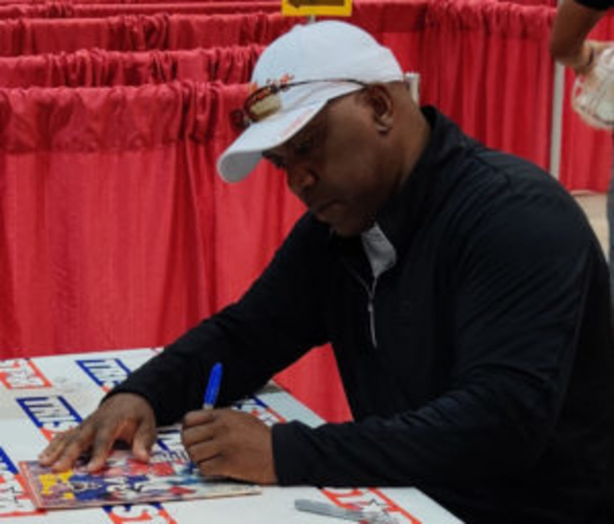 Football Hall of Famer Thurman Thomas signs autographs at the autograph pavilion.
