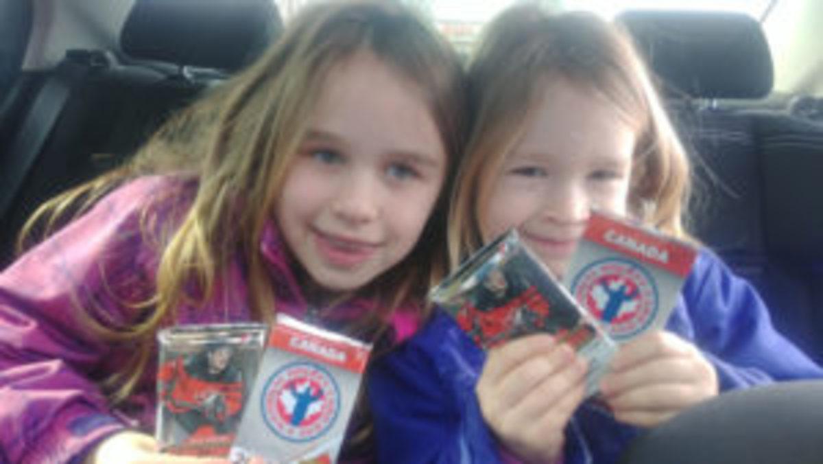 Members of the Poray family enjoy the spoils of National Hockey Card Day held February 23. (Photo courtesy Tom Poray)