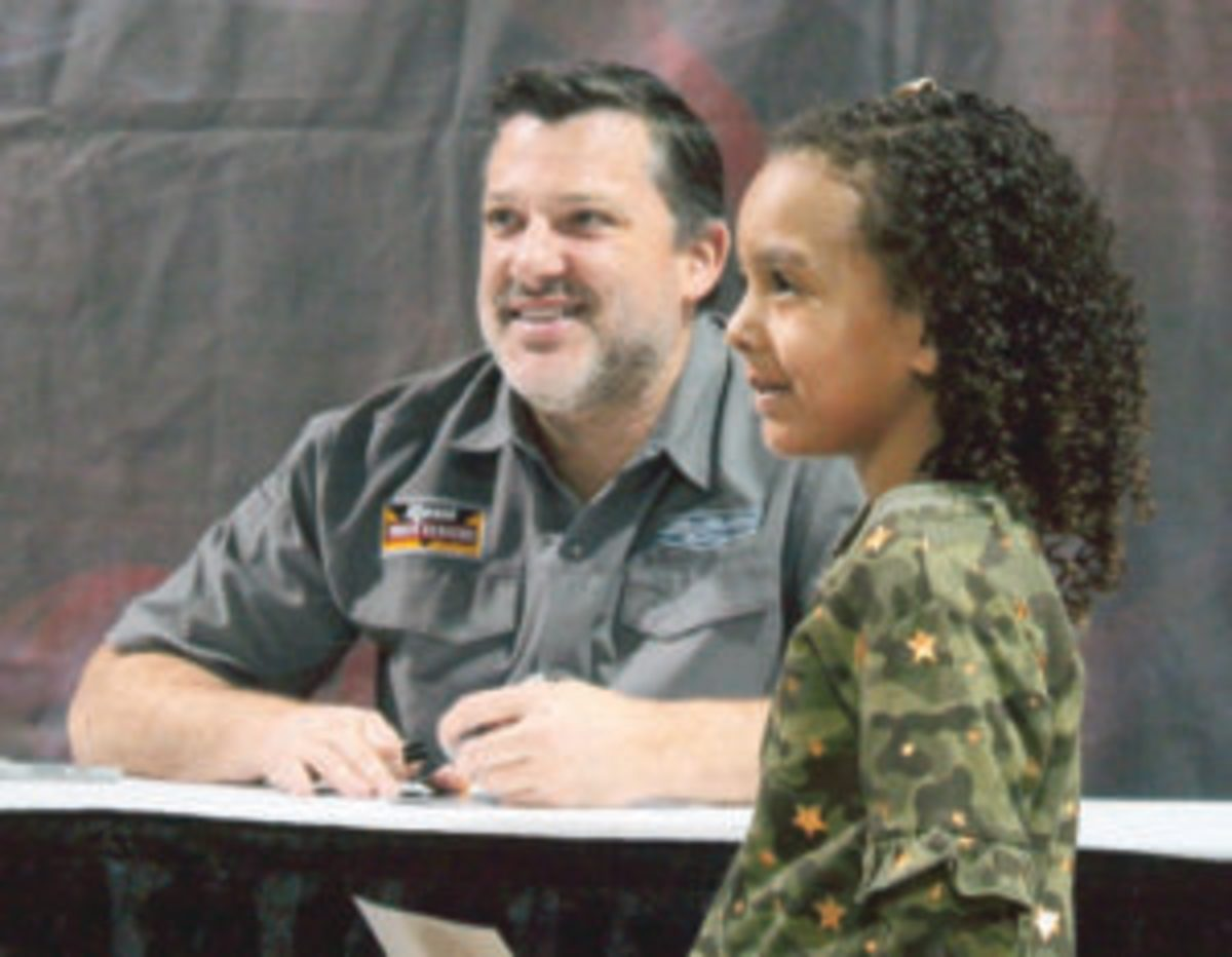 In addition to obtaining Tony Stewart's autograph, attendees of the Chicago World of Wheels Show could also get a photo taken with him. (Rick Firfer photos)