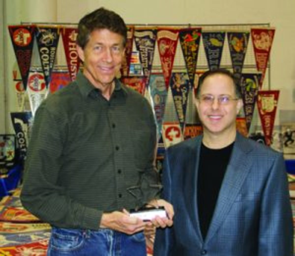 Rick Haskins (left) is presented with the annual Starry Award from Tristar Productions' President Jeff Rosenberg (right) at the 31st annual Tristar Collectors Show in Houston in February.