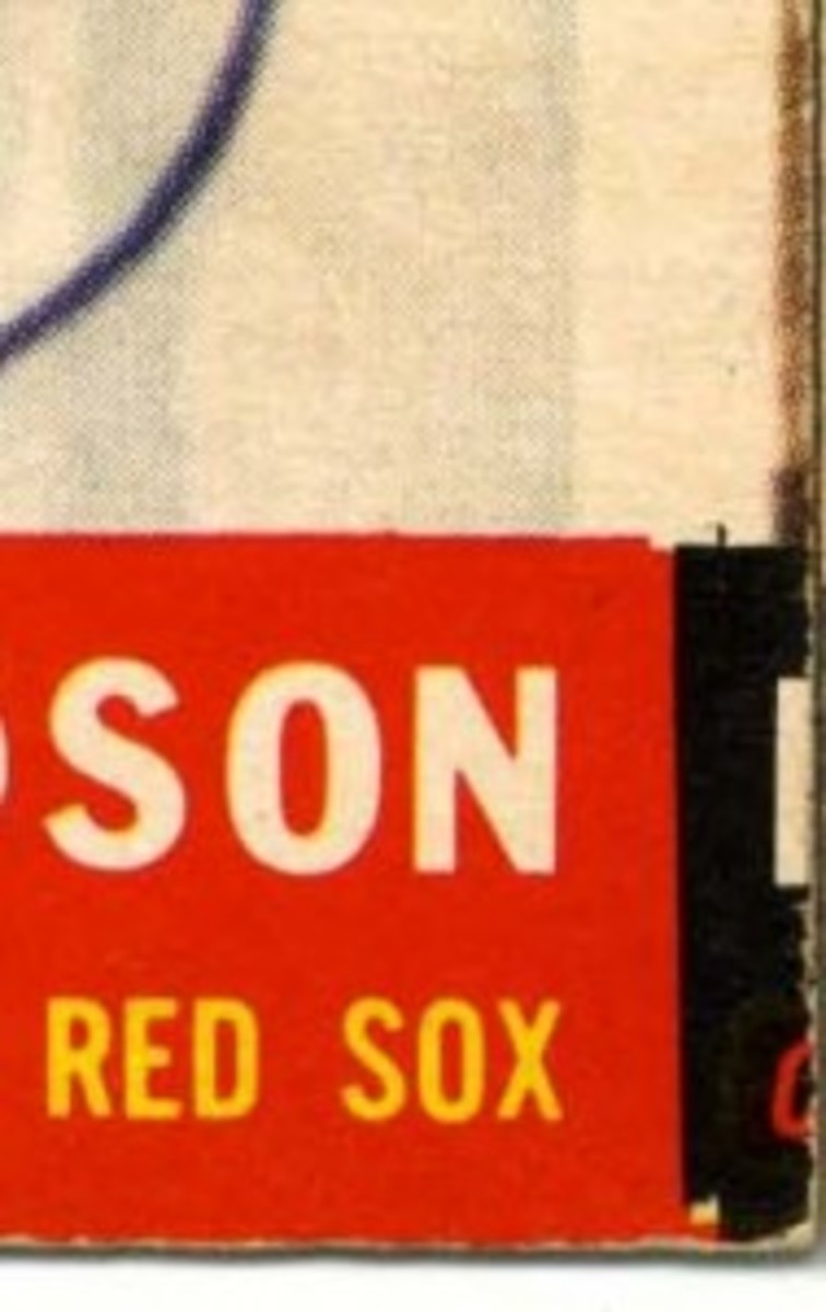 The loose string was an off-center Lou Hudson showing an adjacent black border.