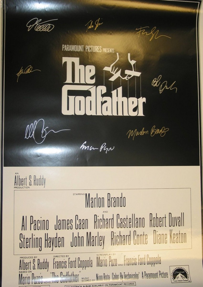 """Buyers of cast-signed posters such as this one of """"The Godfather"""" apparently believe that the stars of the movie came together as a group to autograph it. They did not. It's a fake."""