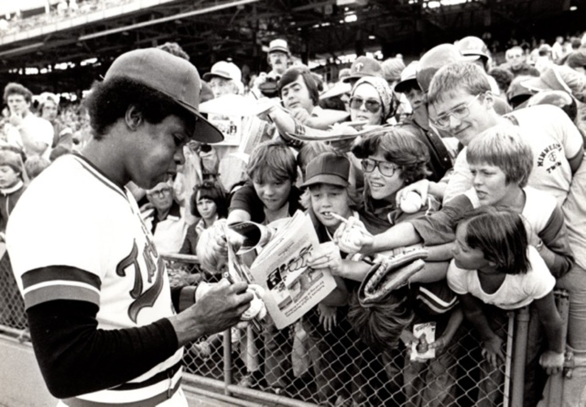 Rod Carew of the Minnesota Twins signs autographs at Yankee Stadium in a vintage 1978 shot.
