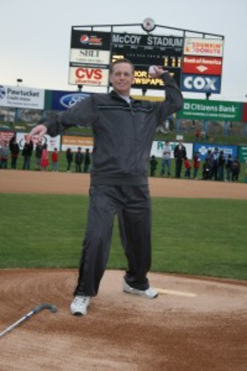 Dave Koza throws out the ceremonial first pitch during the 30th anniversary celebration of the longest baseball game ever played at McCoy Stadium in April 2011.
