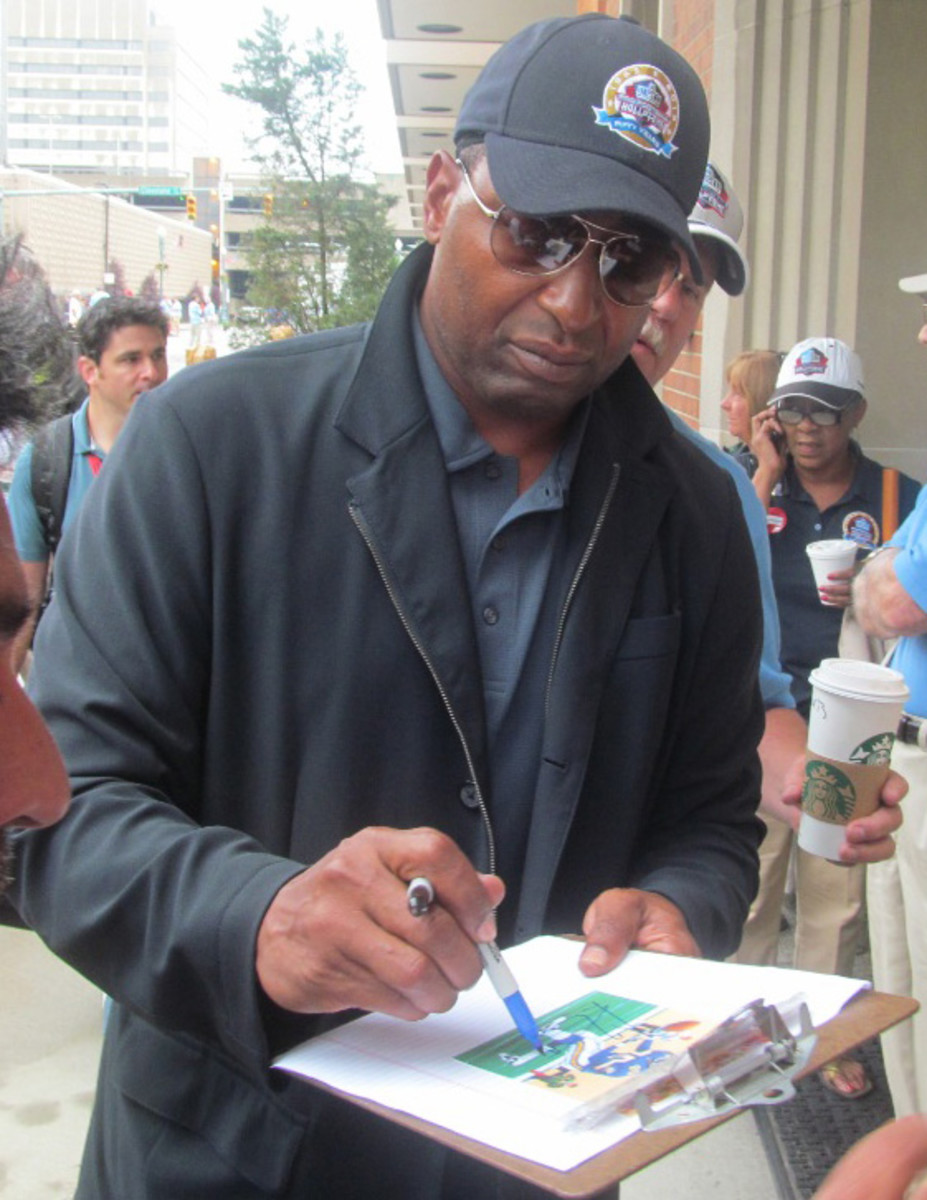 Cris Carter took some time to sign for fans during the induction weekend. At the advice of his coach in high school, Carter dropped basketball and focused on football.