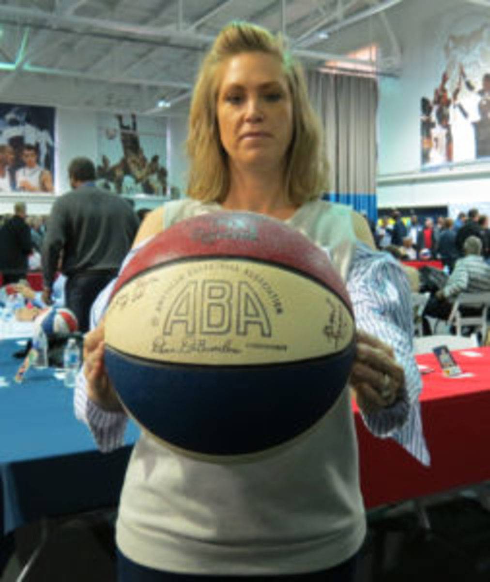 The daughter of former ABA player Grant Simmons collected autographs for her father on an original ABA basketball.
