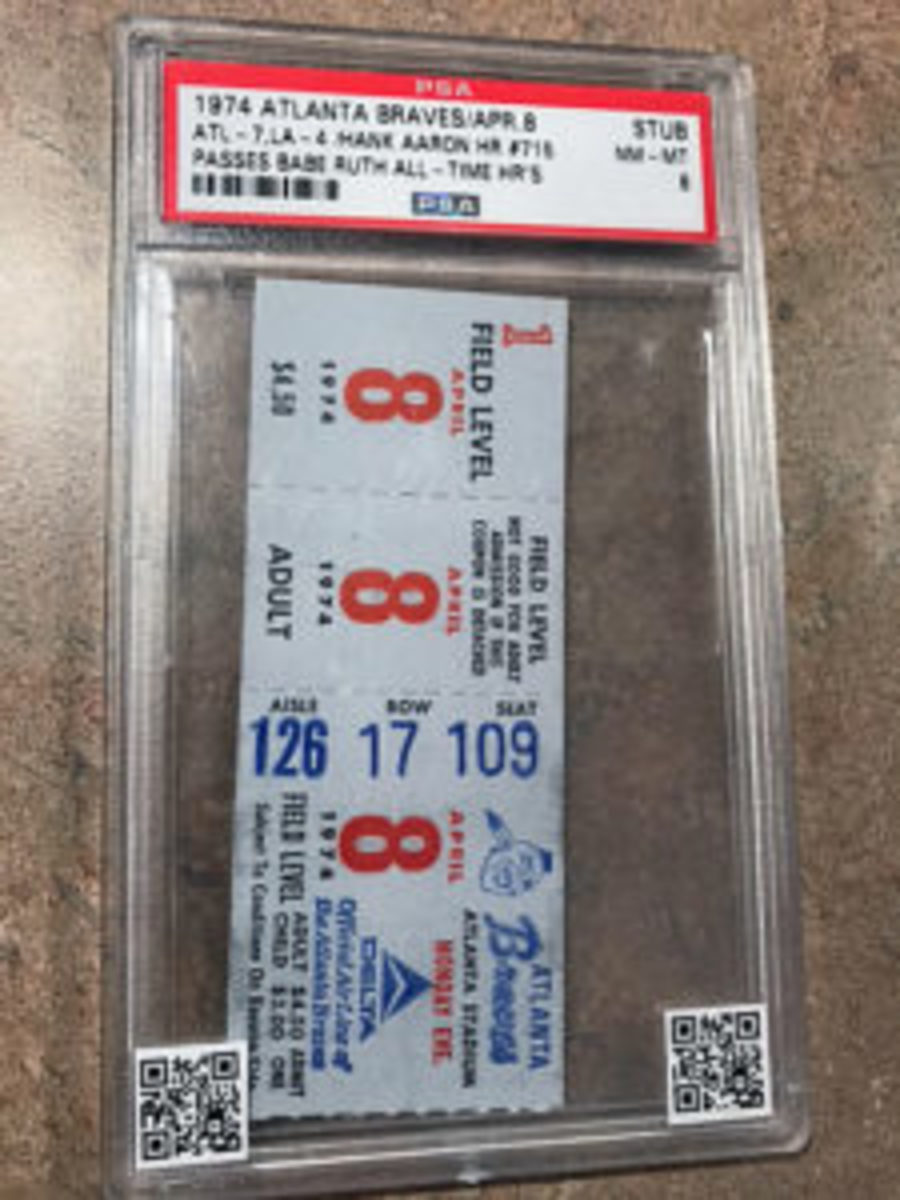 "A graded ticket from the game Hank Aaron broke Babe Ruth's all-time home run record. The QR codes allow the collector to ""witness"" the event."