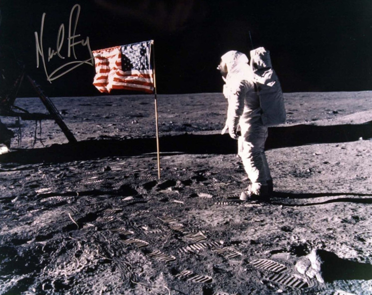 That's Neil Armstrong on the moon, but that's not his authentic signature.
