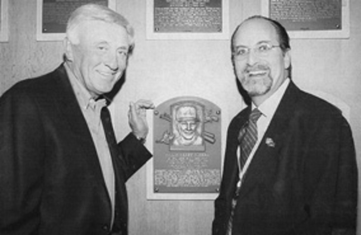 Phil Niekro, left, and John Baker