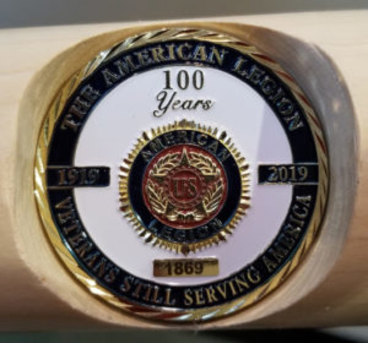A close-up of the portion of the bat recognizing the 100th anniversary of the American Legion.