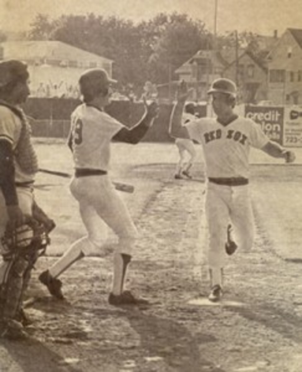 Marty Barrett scores the winning run in the continuation of the 33-inning game on June 23, 1981. He is being congratulated at home plate by Wade Boggs.
