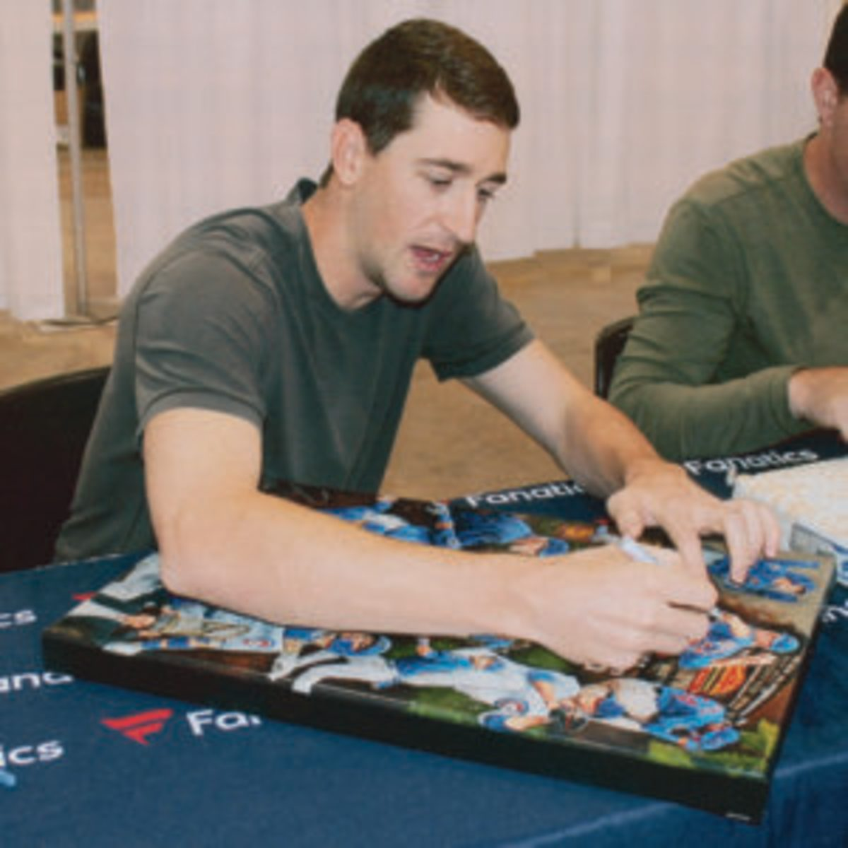 Chicago Cubs starting pitcher Kyle Hendricks signs a collage for a fan. (Rick Firfer photo)