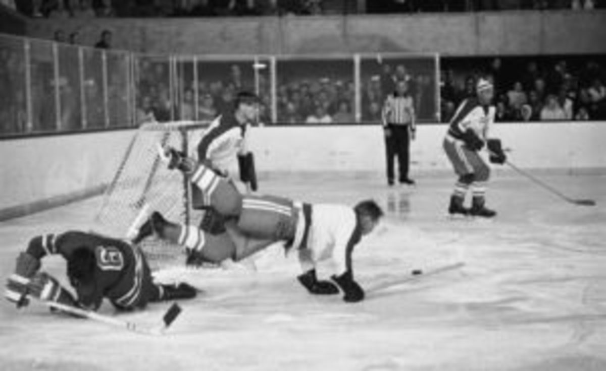 John Mayasich (third from left), defenseman for Team USA, on the ice during the final round of men's ice hockey with the Soviet Team at the 1960 Winter Olympic Games in Blyth Arena at the Squaw Valley Ski Resort, Olympic Valley, California, Feb. 27, 1960. American Jack McCartan (right), goalie for Team USA, guards the goal. The American team scored a 3-2 victory over the Soviet Team and eventually won the gold medal. (Photo by Bruce Bennett Studios/Getty Images)