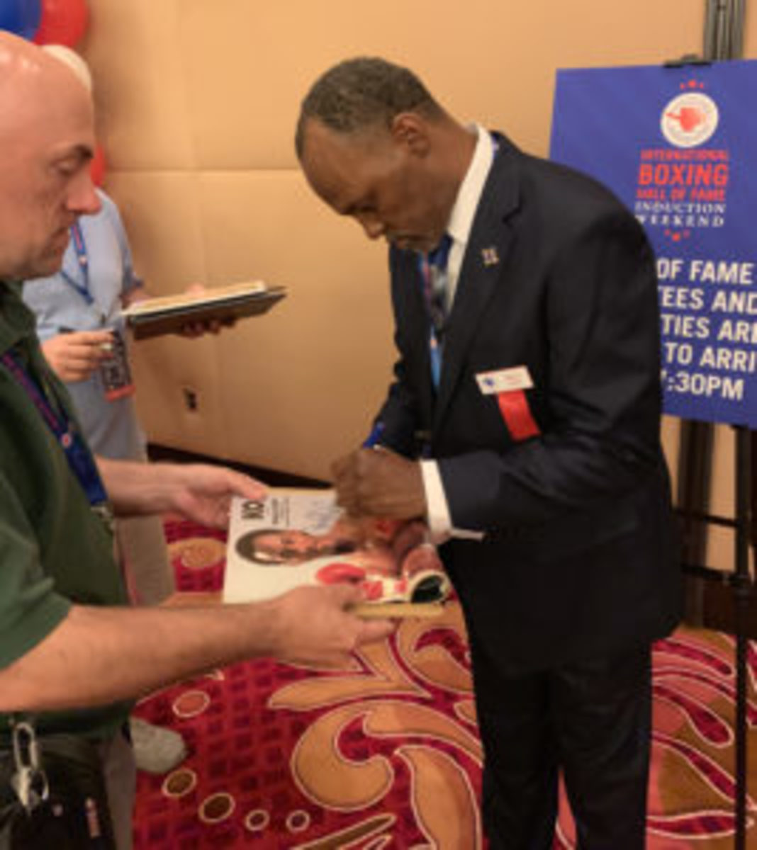 Donald Curry signs autographs for collectors at the VIP Boxing Card Event.