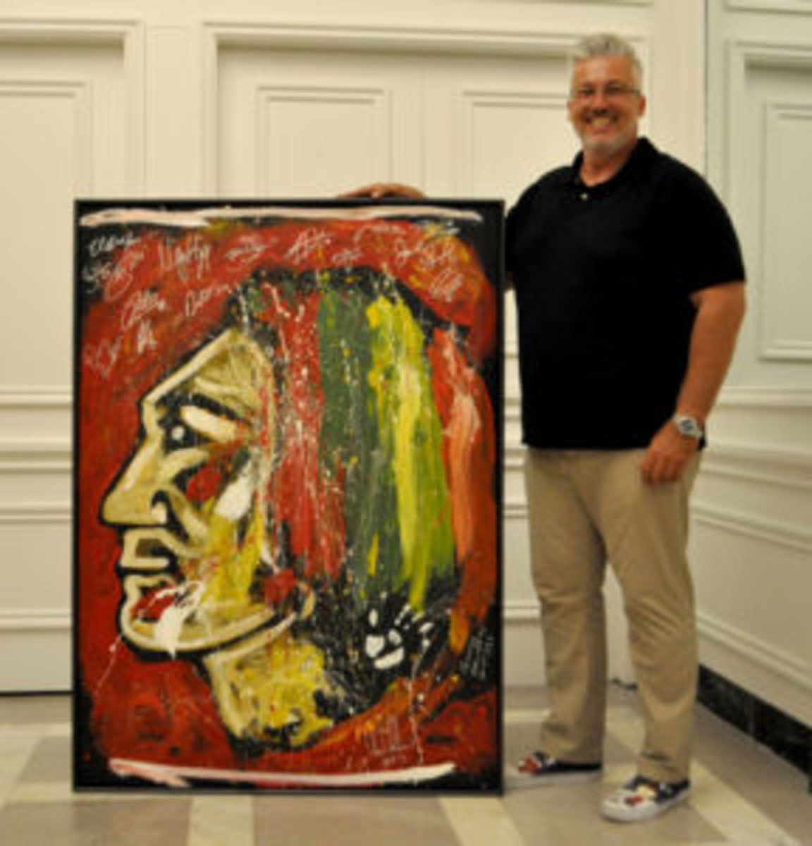 Lower attendance at this year's Convention encouraged fan Don Metter to bring along his 5-foot Blackhawks logo painting to get autographed.