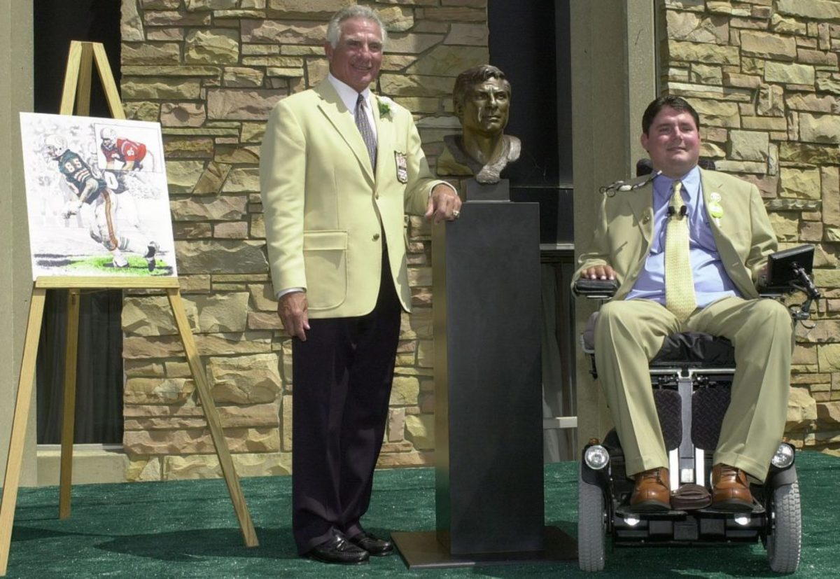 Nick Buoniconti, with son Marc, at the 2001 Pro Football Hall of Fame induction ceremonies in Canton, Ohio. Marc introduced his father, calling him his hero. DAVID MAXWELL/AFP/Getty Images