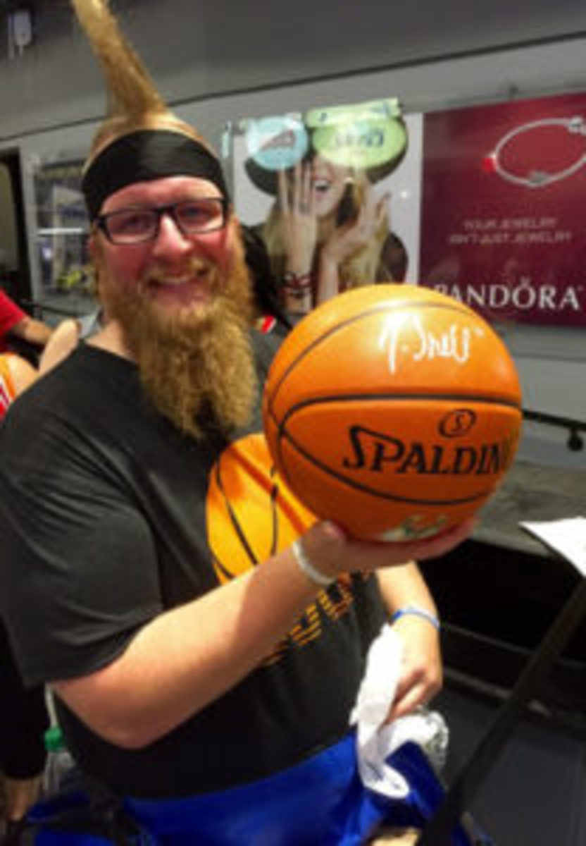 Joe Axtman proudly displays his Tony Snell-signed basketball garnered at the NBA Summer League.