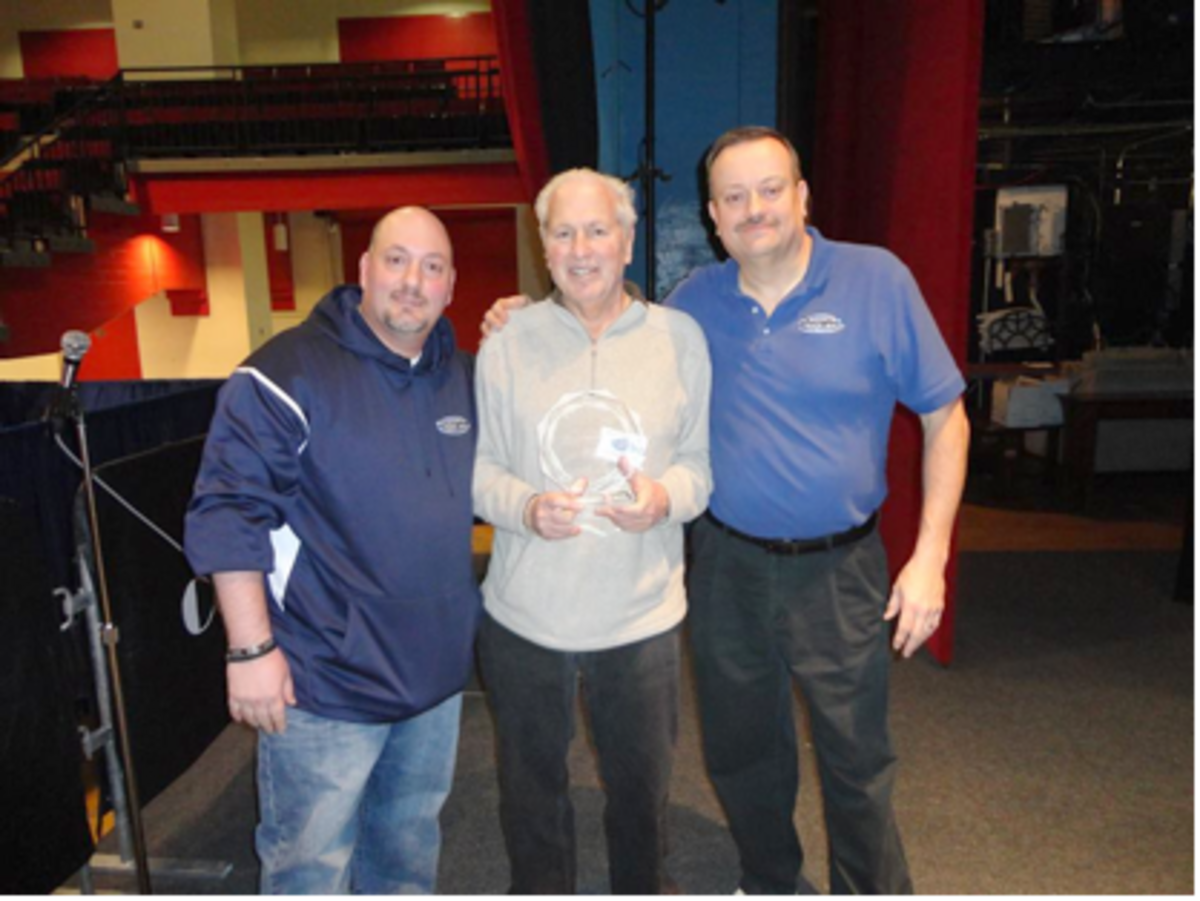 JPRS promoters Brian Coppola (left) and James Ryan (right) with dealer Ron Vitro (center) moments after the award presentation ceremony for the Award of Excellence. Photos courtesy of Marty Zajac.