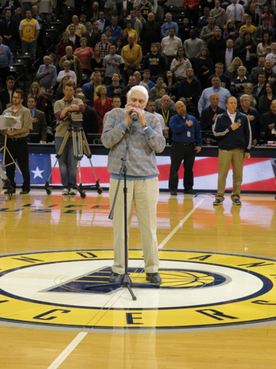 Carl Erskine performs the National Anthem on his harmonica prior to the tip-off between the Brooklyn Nets and Indiana Pacers at Bankers Life Fieldhouse on Feb. 11, 2013.