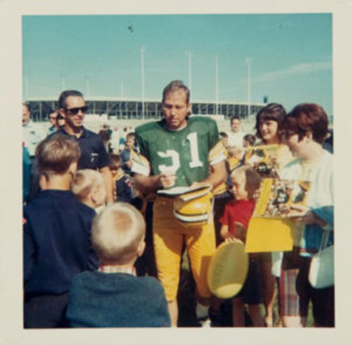 Bart Starr signs for fans at training camp in 1967. (Image courtesy Heritage Auctions)