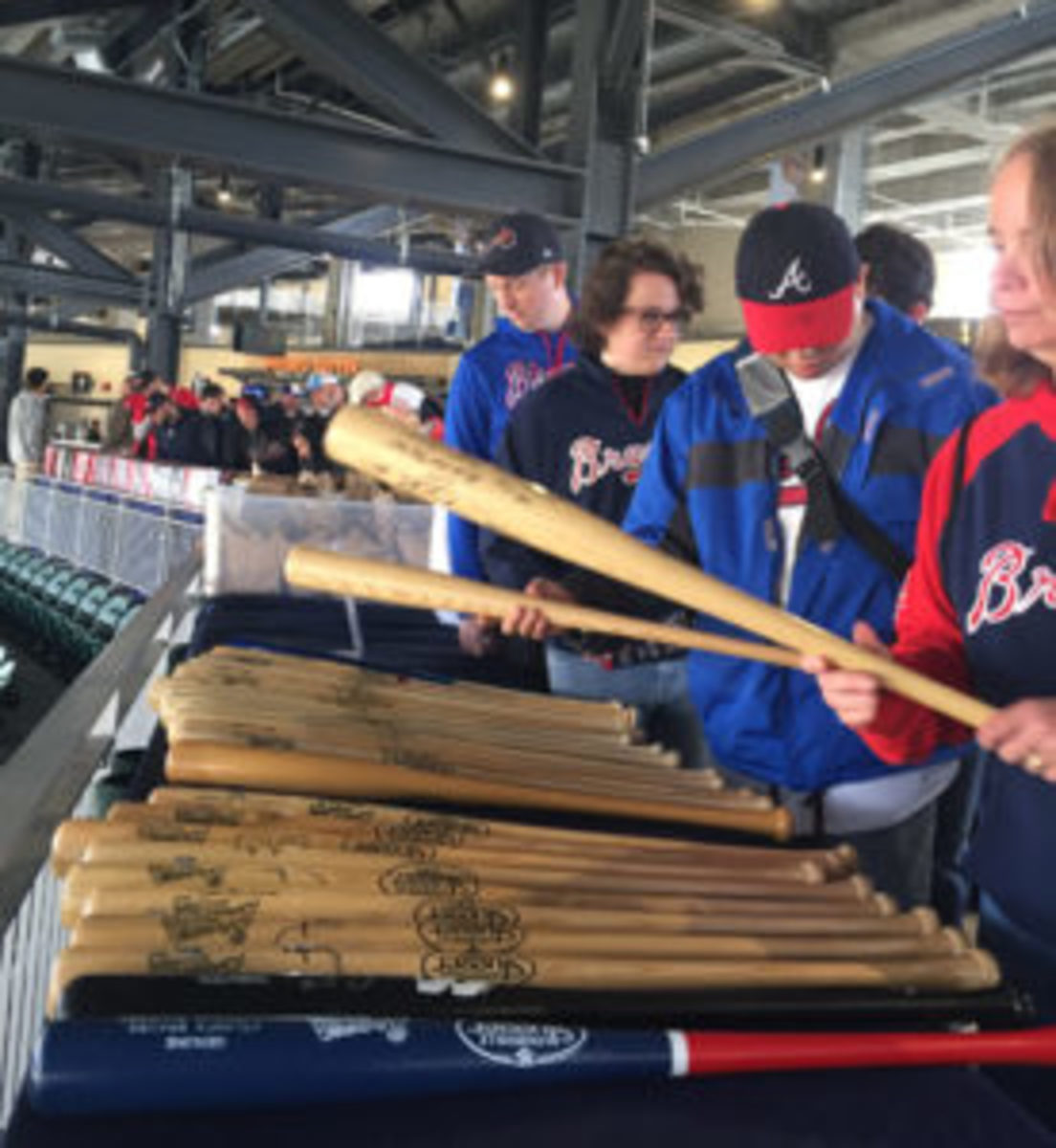 "Signed bats on display at the ""Yard Sale."""
