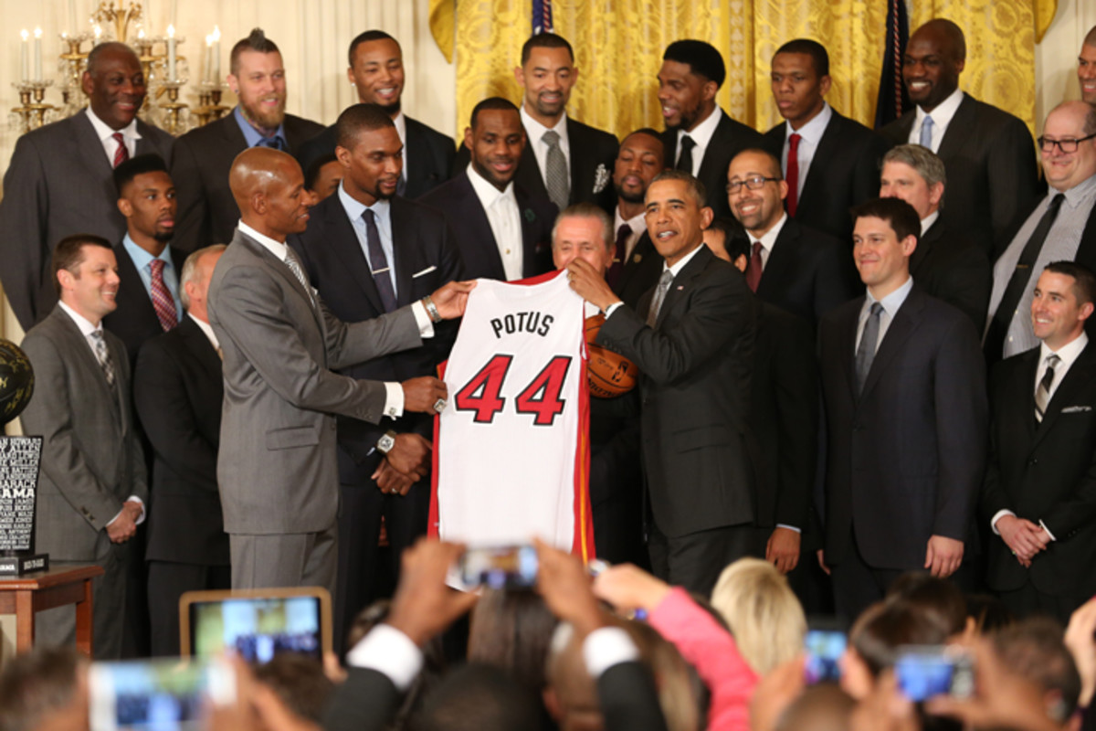 WASHINGTON, DC - JANUARY 14: Ray Allen #34 of the Miami Heat and U.S. President Barack Obama smile and pose for pictures while the President receives a Miami Heat jersey during a visit to the White House to celebrate their 2013 NBA Championship on January 14, 2014 in Washington, DC. NOTE TO USER: User expressly acknowledges and agrees that, by downloading and or using this photograph, User is consenting to the terms and conditions of the Getty Images License Agreement. Mandatory Copyright Notice: Copyright 2014 NBAE (Photo by Ned Dishman/NBAE via Getty Images)
