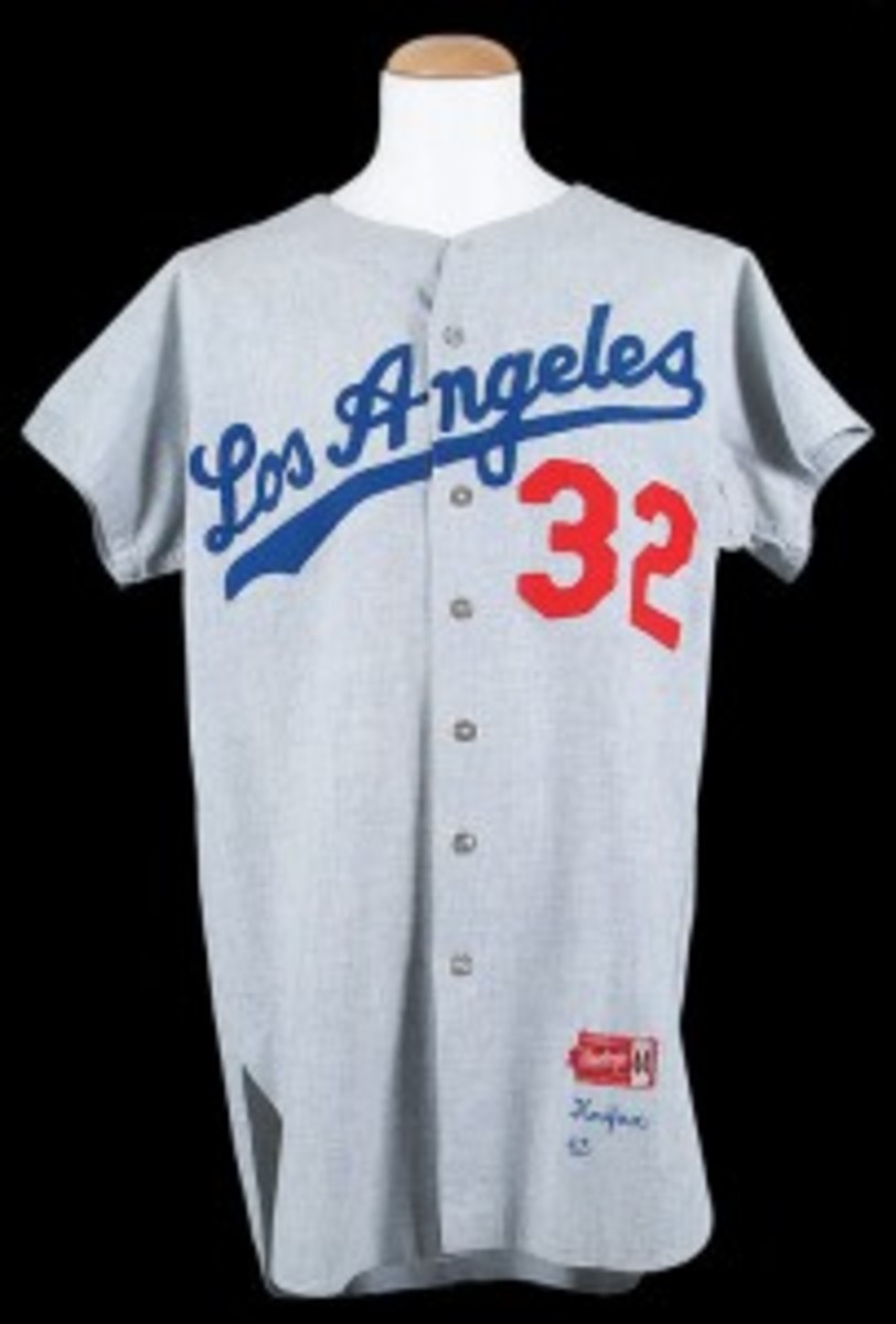 ) 1963 Sandy Koufax Los Angeles Dodgers Game-Used Road Jersey - MVP and Cy Young Award-Winning Season (res. $25,000; est. $50,000+) sold for a record $201,450.