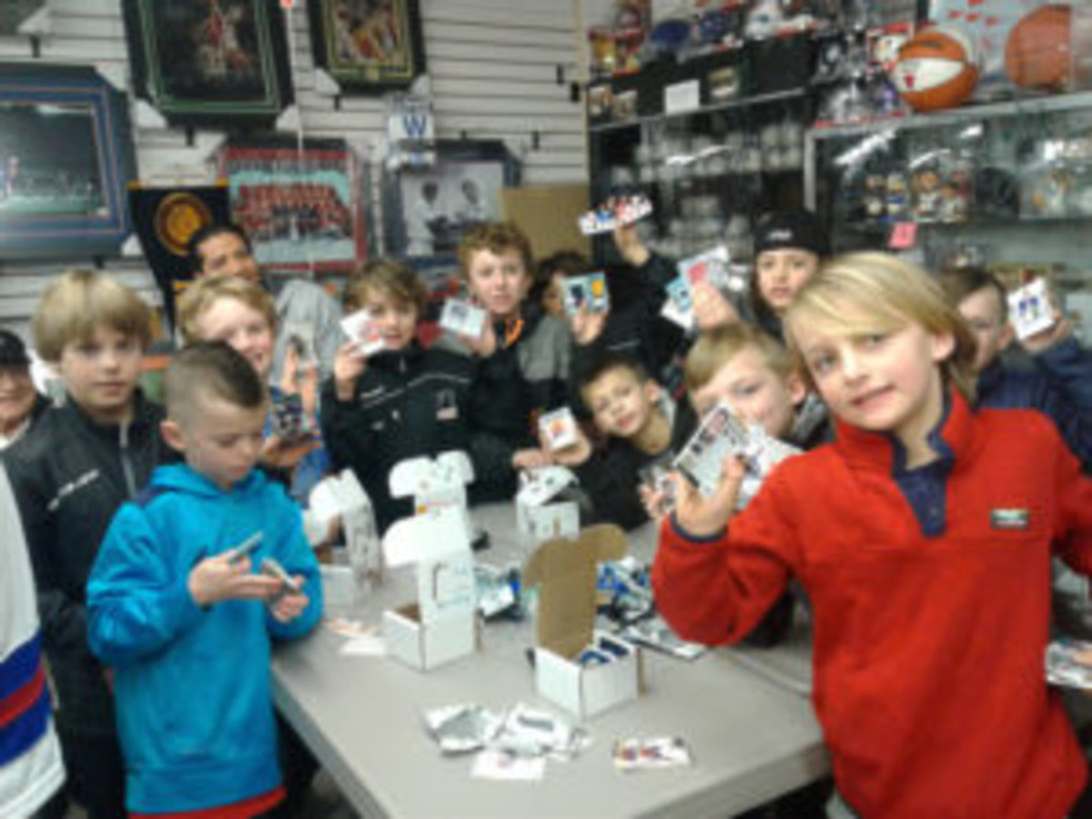 Kids who attended National Hockey Card Day at Jim & Steve's Sportscards in Waukegan, Illinois proudly show off the hockey cards they received. (Photo courtesy Jim & Steve's Sportscards)