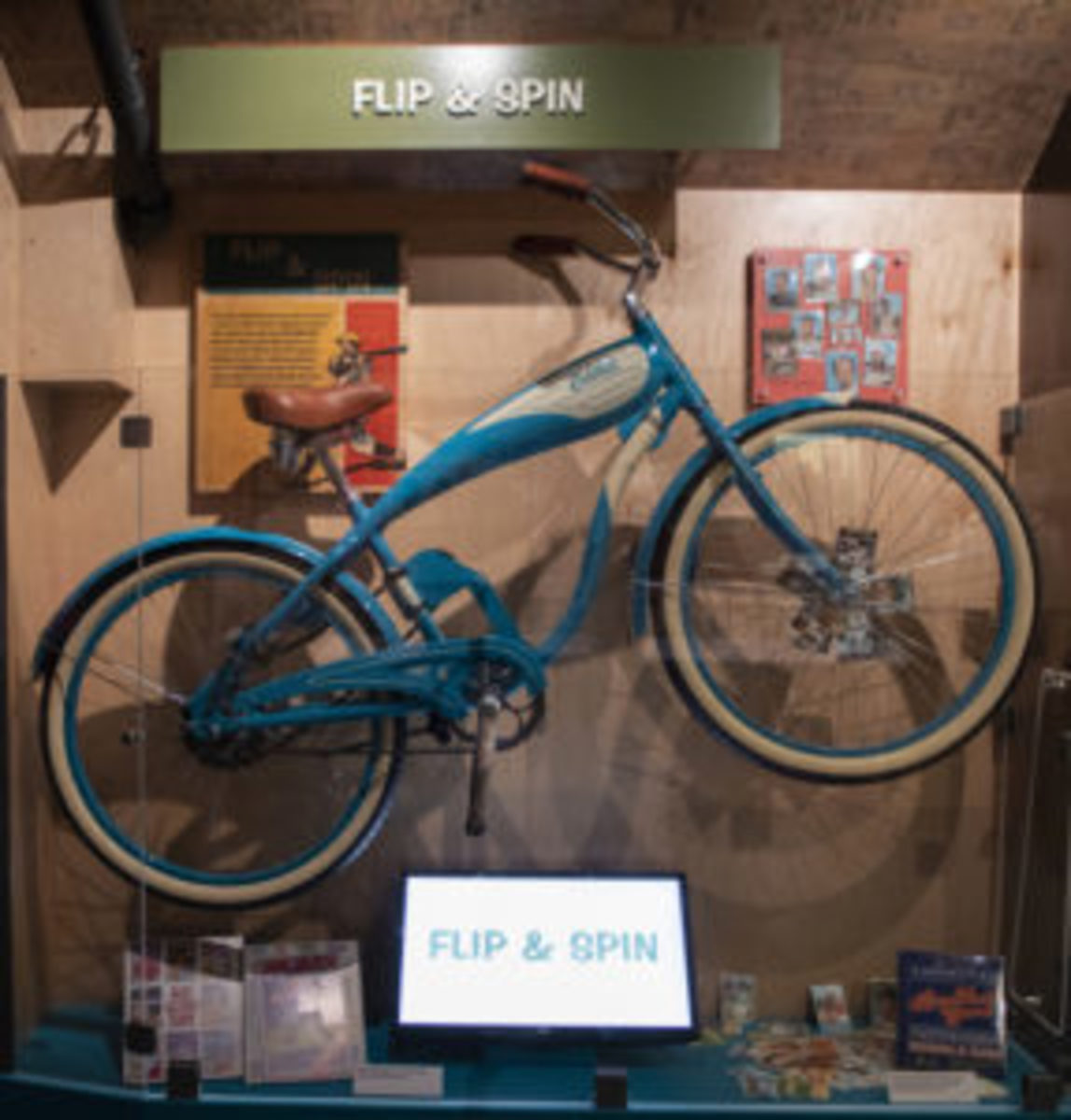 The Shoebox Treasures exhibit features a bicycle with baseball cards in its spokes. The will can be spun by attendees so they can hear what that sounds like.