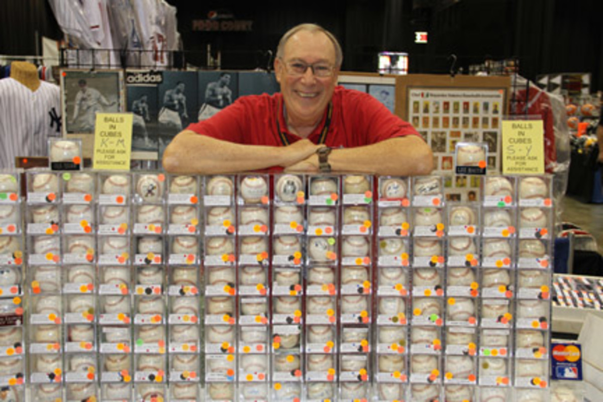 Barry Krizan specializes in baseball signed by, well, non-baseball players such as Lou Rawls and bowler Dick Weber. Photos by Ross Forman.