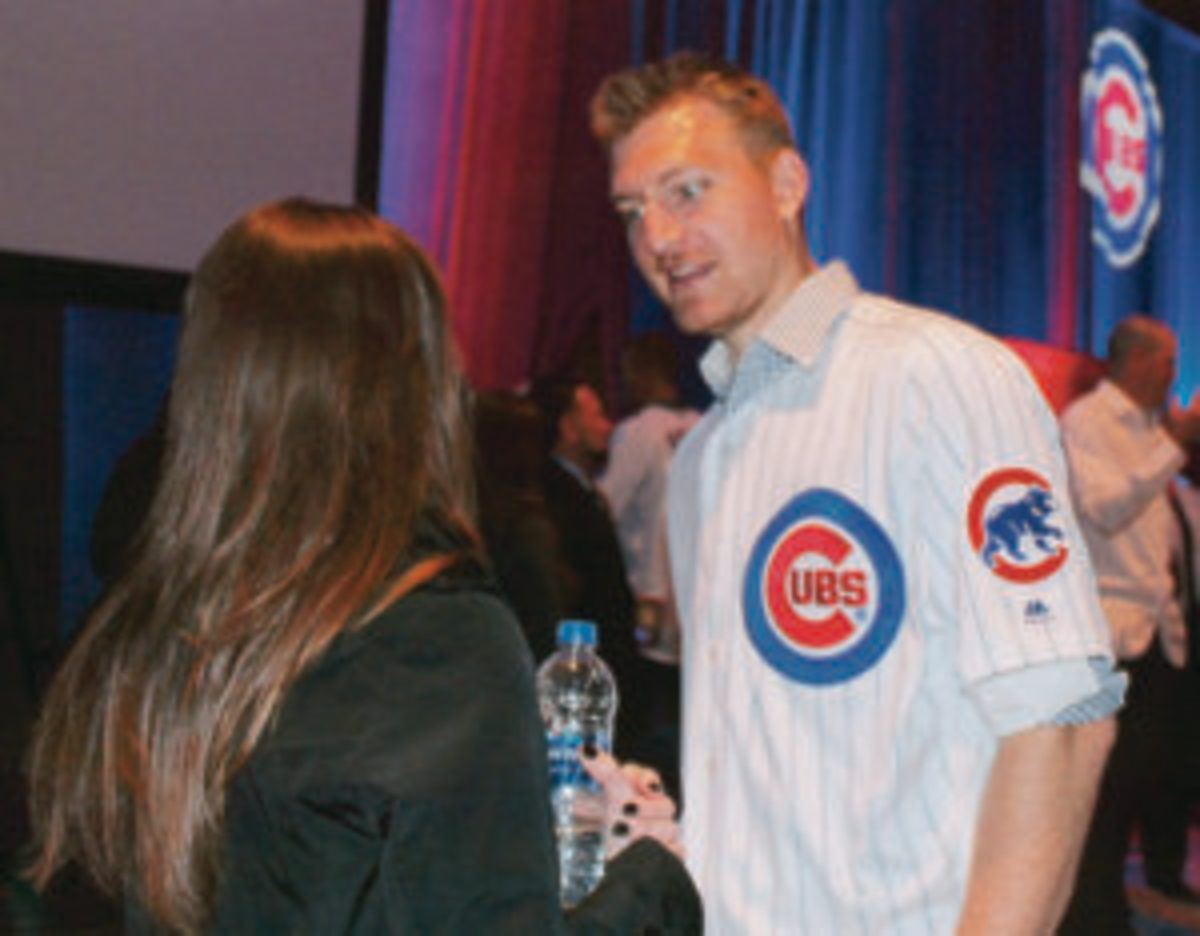 Cubs pitcher Mike Montgomery chats with a fan at the Cubs Convention.