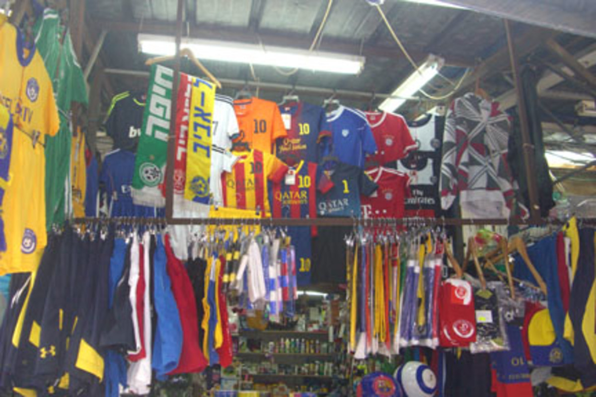 Soccer is king in Israel, as shown by the displays at the Carmel Market, a popular destination for tourists.