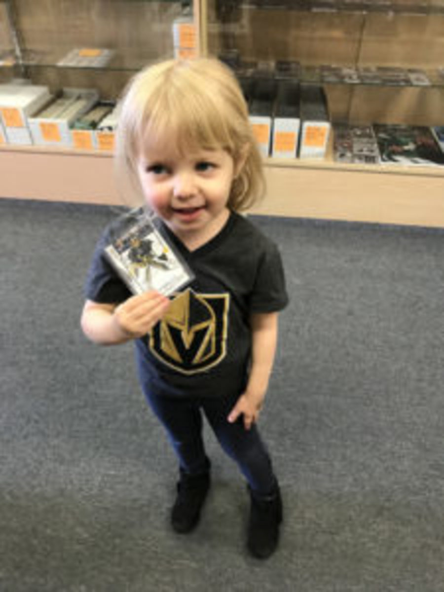 This young Las Vegas Golden Knights fan was happy to receive this Golden Knights card at Legacy Sports Cards in Las Vegas. (Photo courtesy Legacy Sports Cards)